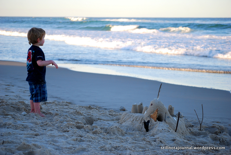 kid looking out to sea Lennox Head beach ocean sandcastle