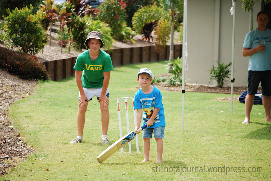 It's summer... in Australia... backyard cricket... duh.