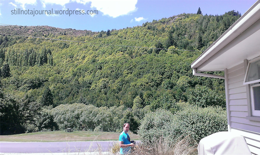 The view from our side deck. Hidden in the trees at the bottom of that hill mountain is the Arrow River. Walk into the trees then turn left for Arrowtown.