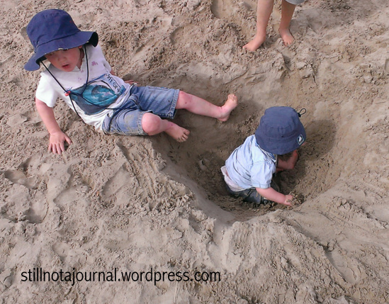 Experimenting with different styles of parenting. I believe this one's 'Turtle Style' which I mentioned in my last post, ie  dig a hole in the beach and leave your kid in it. They seem to like it and at least they stay where you left them.