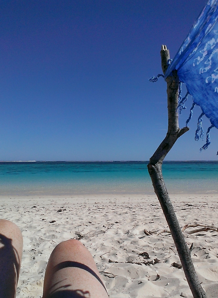 Enjoying the view from my makeshift sun shelter; a stick, the fence line and my sarong. Glad I had something; even in midwinter the sun was vicious and there is no shade. Stuff getting shipwrecked around here!