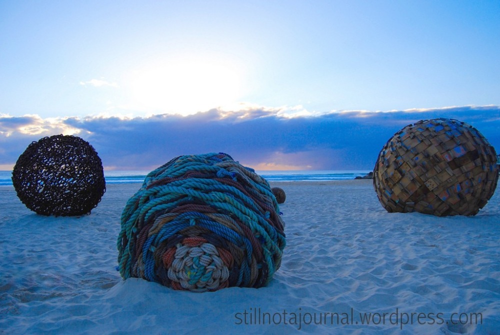 Relics from Atlantis, Ben Carroll. I love it. Looks like perfect spheres of ocean flotsam left by the tide.