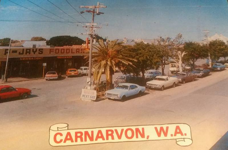 The main street of Carnarvon in the 1970s. A little desert oasis town on the West Australian coast. Huge wide street big enough for camel trains to pull a u-turn back in the day, and for walking down the middle of after getting kicked out of the Carnarvon Hotel at closing time (midnight)