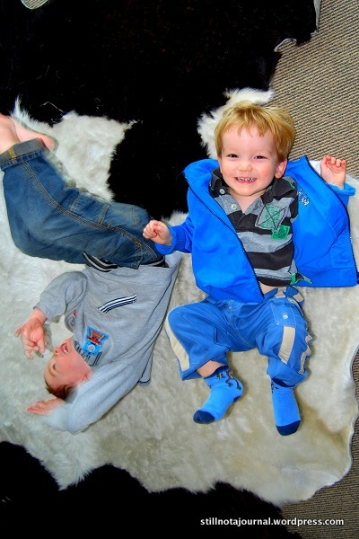 Boys breakdancing on a cow carpet?