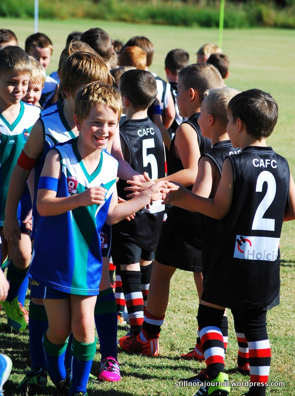 The traditional post-game team hand shake and cheer for the opposing team. Onya guys!